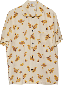 Short sleeve shirt made from Finnish vintage cotton from the 1970ies. This item is one-of-a-kind and made by hand in Denmark. 100% cotton  Loose fit - Small Mother of Pearl buttons unisex