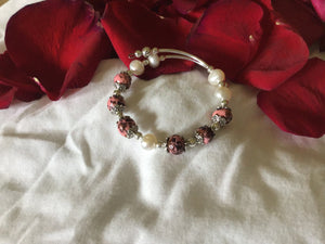 Expandable rose and clay bracelet