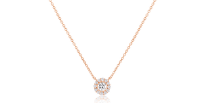 Inspired by the timeless beauty of a diamond, this handcrafted necklace comes in 18 Karat gold and is adorned with a glistening ensemble of diamonds.