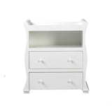 The chest of drawers with changing unit and open shelf has a beautiful sleigh shape with gentle curves and finished in white