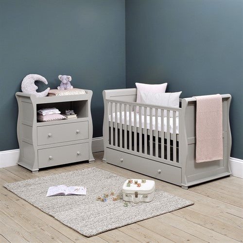 This 4-in-1 warm Grey Sleigh Cot Bed with Drawer is a beautiful Wooden Cot, Toddler Bed and day bed