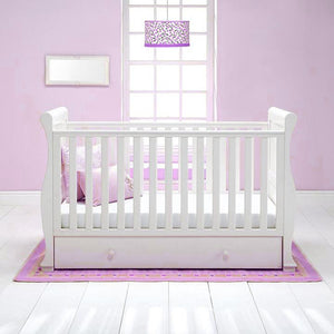 This 4-in-1 warm white Sleigh Cot Bed with Drawer is a beautiful Wooden Cot, Toddler Bed and day bed