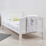 This eco-friendly 2-in-1 cotbed and junior bed converts easily from a cot to a toddler bed with two split end panels.