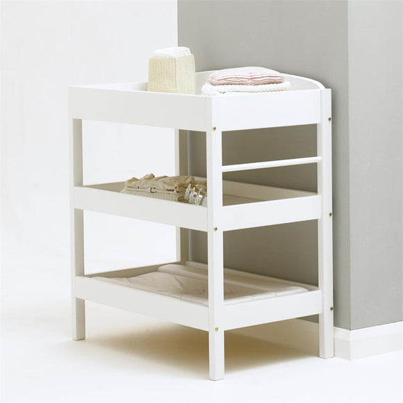 The changing table takes standard changing mats to make this a multi use nursery item