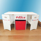 This sturdy table & 2 chairs set comes with a lacquered top for easy cleaning and a large red fabric storage box