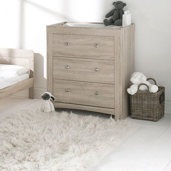 The Fontana Dresser chest of drawers with baby changing unit has a washed-wood finish, ideal with white and neutral shades.
