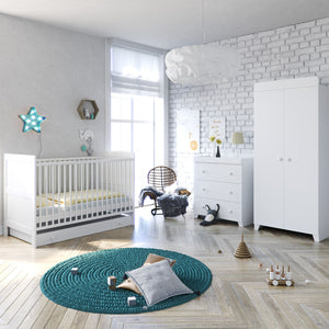 This Italian-Inspired White Nursery Room Set includes cot bed with mattress, dresser, changing station and double wardrobe.