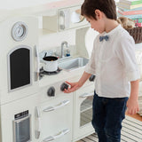 The knobs on the cooker rotate a full 360 degrees on this retro designed wooden toy kitchen