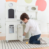 This wooden toy kitchen has a microwave, storage, clock, oven and water dispenser