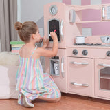 This pink toy kitchen has an abundance of features inc water dispenser, cordless phone, clock, microwave and blackboard