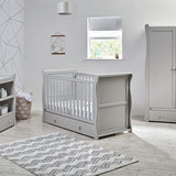 This cot includes a drawer at the bottom, supplying you with a place to store their toys, cuddlies or bedding.
