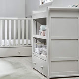The Willow chest of drawers with changing unit features three shelves where you can put your nursery essentials and accessories.