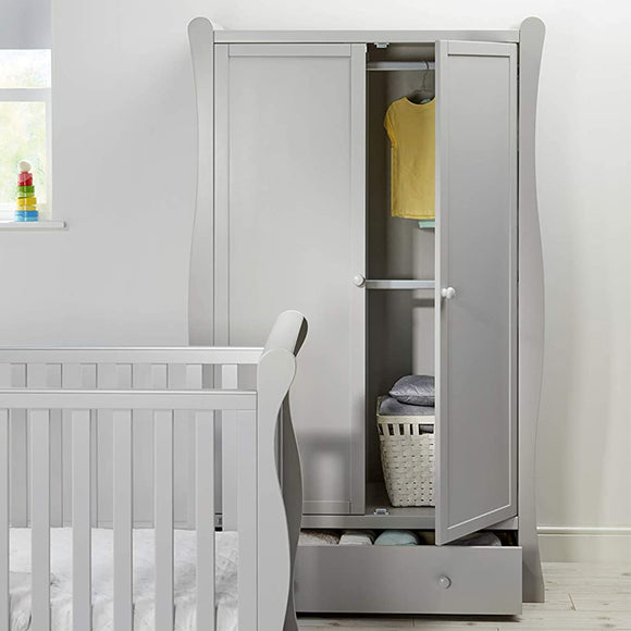 Behind two-sided doors, you will find a spacious interior with a railing where you can hang on your little one's clothing.