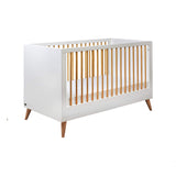 The cot bed has 3 adjustable heights, allowing you to change the height of the mattress.