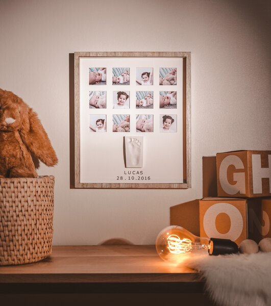 This unique frame is a special way to create a lovely keepsake and memory of your baby's first year and makes an ideal gift