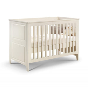Ivory white painted pine nursery cot bed with 3 mattress settings for baby & toddlers. Matching furniture available.