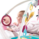 A large mirror hangs from one arch so baby can see himself - another development element on this multi sensory baby play mat