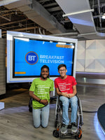 Image of two Holland Bloorview clients wearing dear everybody t shirts on the set of Breakfast Television.
