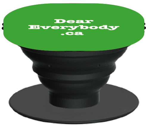 Conveniently sticks to the back of your smartphone or tablet and provides a handy grip so you don't drop it. It also acts as a stand and a cord manager when opened. DearEverybody.ca imprint in green.