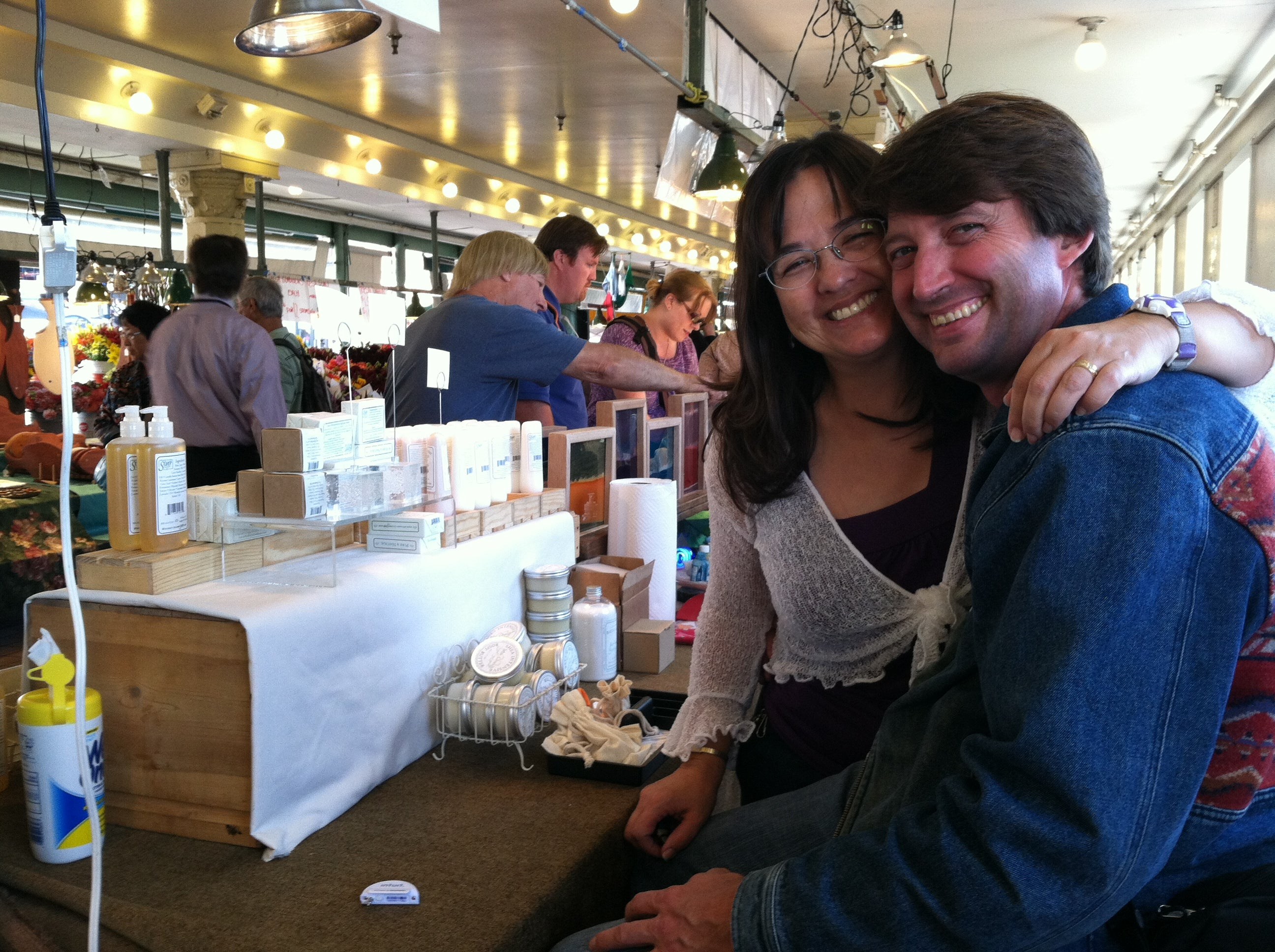 David working and Gayle visiting together at Pike Place Market