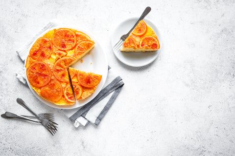 Citrus cake with forks and napkin