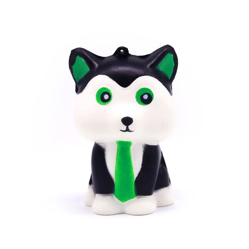 A white and black dog squishy, with green eyes and ears, wearing a green tie