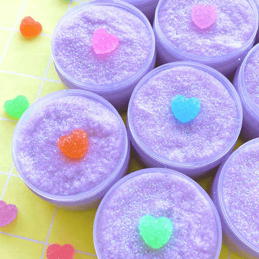 Pastel snow fizz crunchy purple slime with holographic glitters and sour heart candy charm in rainbow of colours.