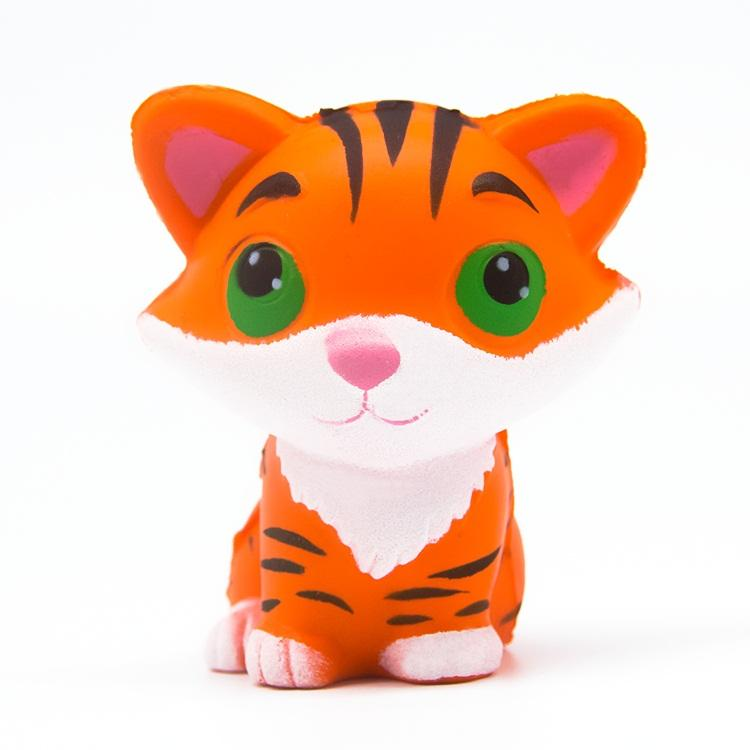 An orange tiger squishy with brown stripes, white belly and green eyes.
