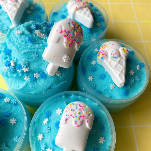 Blue cloud slime with snow flake sprinkles and white airdry clay ice-cream to mix in.