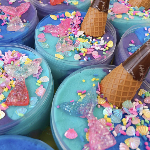 Purple, blue and turquoise slime with sparkly shell sprinkles, ice-cream cone charm and mermaid tail charm.