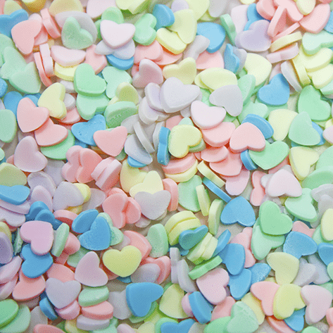 A mix of pastel coloured heart shaped sprinkles