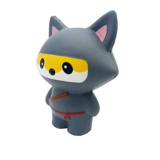 A dark grey fox ninja squishy with a red belt and bamboo stick.