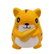 An orange hamster squishy with brown stripes