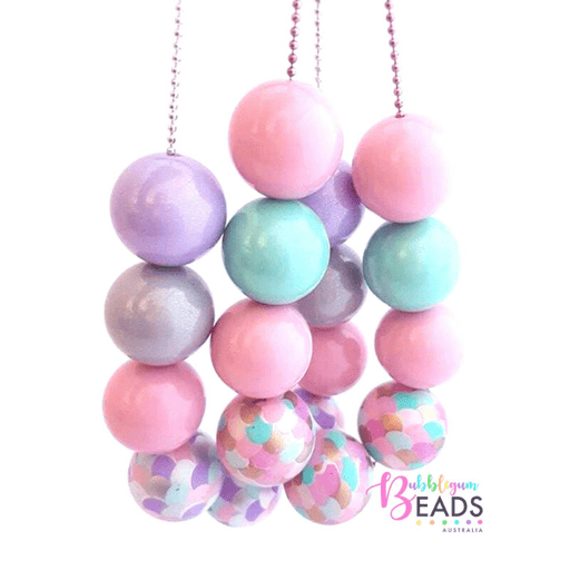 Several pastel coloured beads