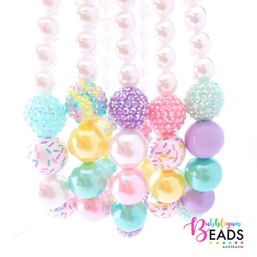 Several pastel coloured beads and other textured beads
