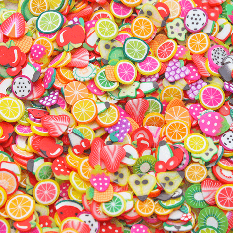 A mix of multicoloured sprinkles with several fruit shapes