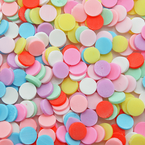 A mix of pastel coloured round sprinkles
