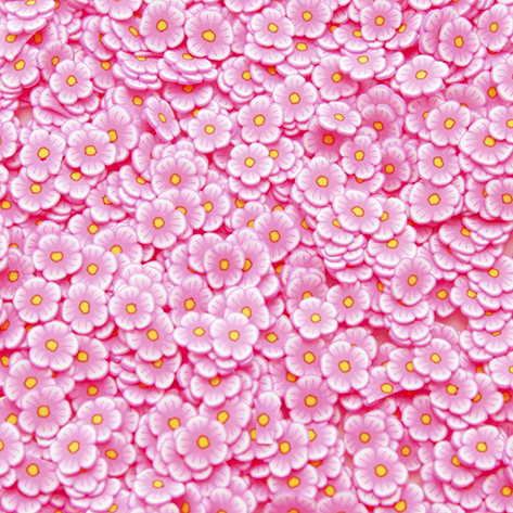 A mix of pink flower shaped sprinkles