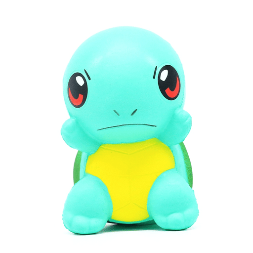 A mint coloured squishy with the shape of a tortoise, has a yellow belly and and angry expression in its face.