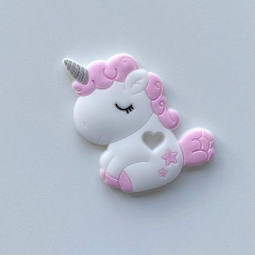 White baby teether with the shape of a white unicorn and pink hair