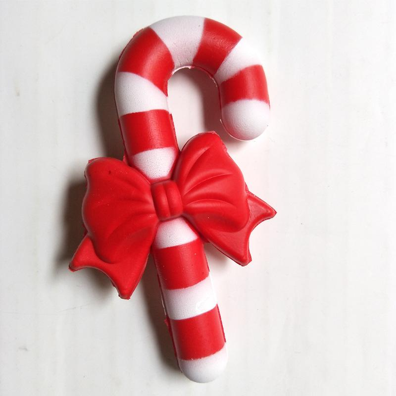A red and white striped squishy that resembles a Christmas candy cane, with a red bow in the middle.
