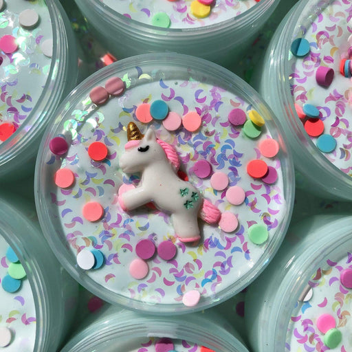 Close up to the dreamy unicorn slime with unicorn charm and colourful sprinkles