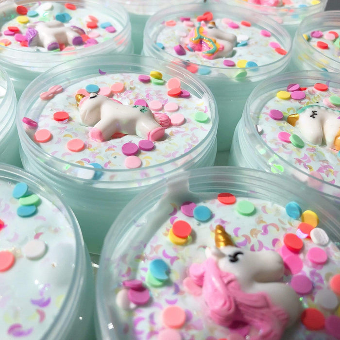 Several dreamy unicorn slimes in their containers
