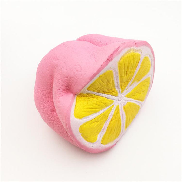 A squished pink lemon slice squishy