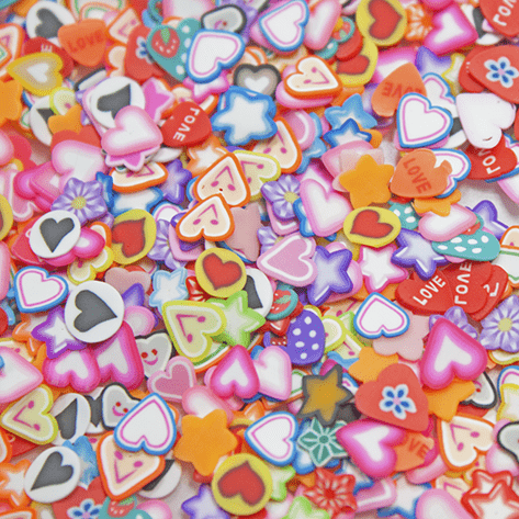 A mix of multicoloured sprinkles with the shapes of hearts, stars and circles