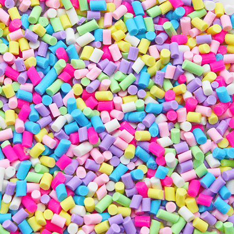 A mix of bright coloured mini sprinkles