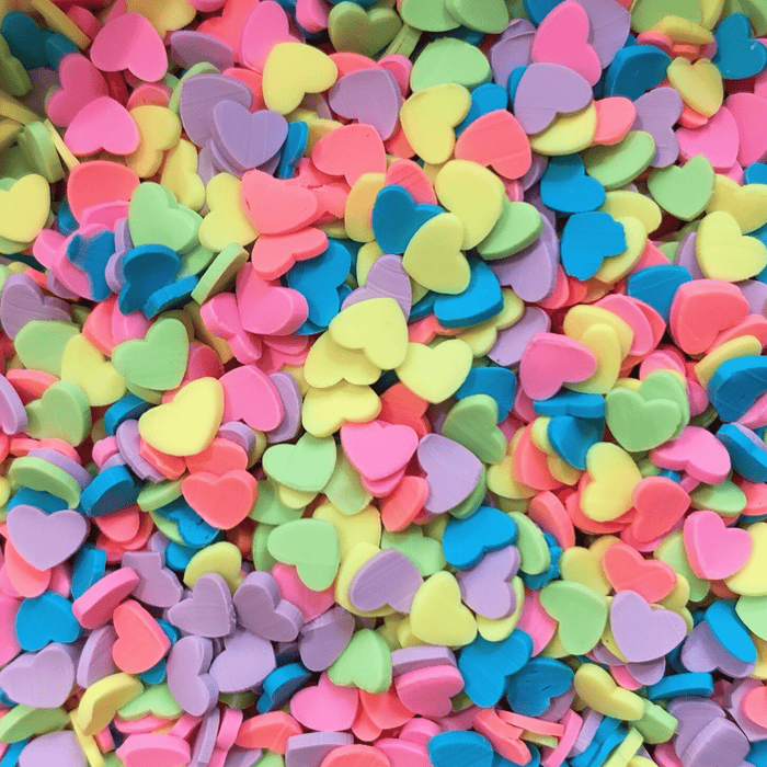 A mix of bright coloured heart shaped sprinkles