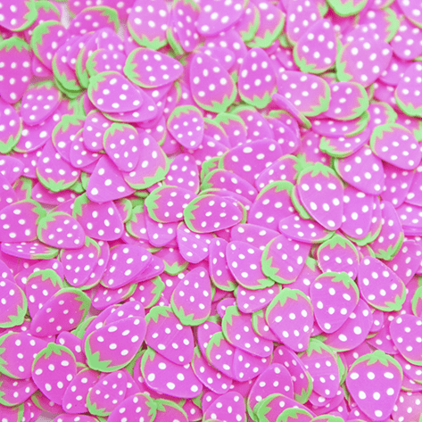 A mix of bright pink strawberry slices sprinkles