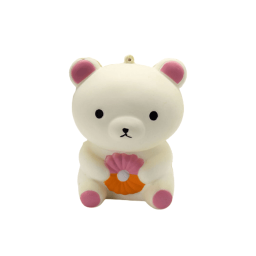White bear squishy with pink ears and paws, holding a pink and orange cronut in its belly.
