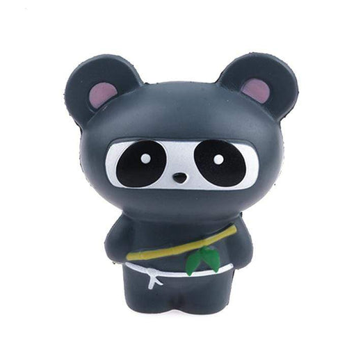 A black panda squishy dressed as a panda with a white cord and a bamboo stick.